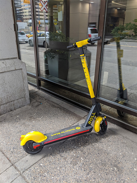 Roll scooter in Calgary located on a sidewalk