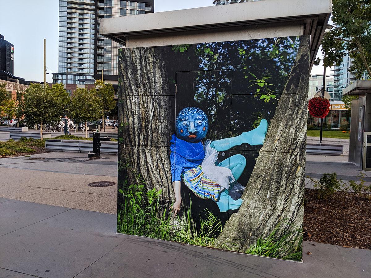 East Village Mask Mural Blue in tree