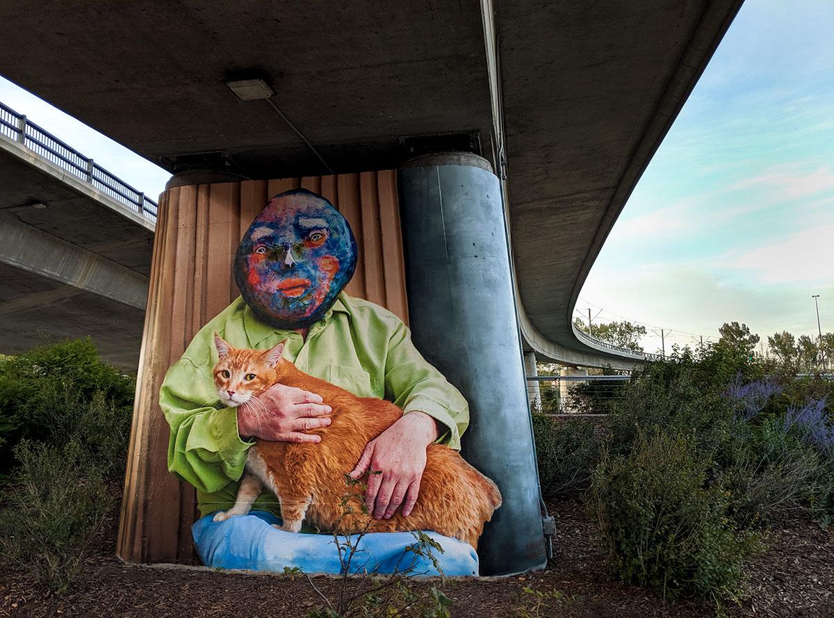 East Village Mask Mural orange cat