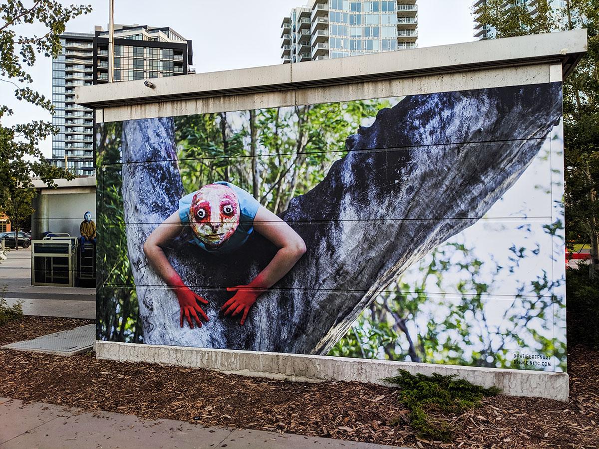 East Village Mask Mural red hands
