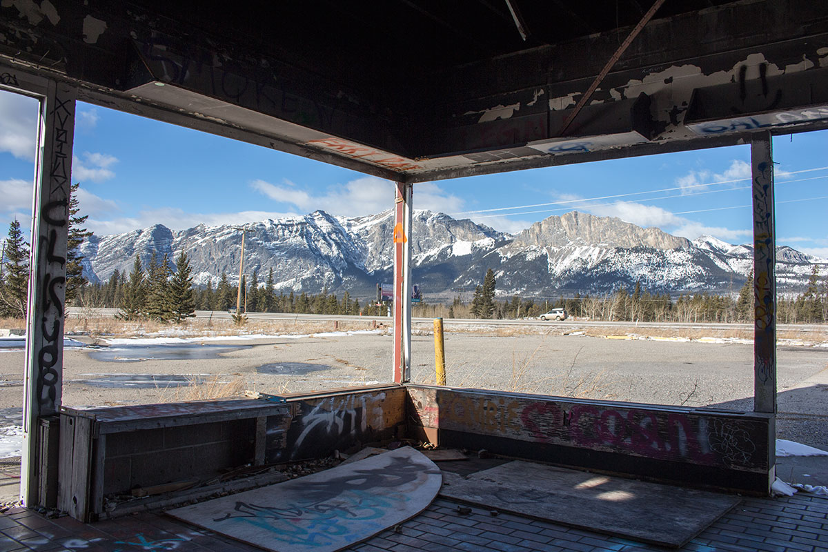 Fort Chiniki Abandoned Gas Station Between Canmore and Morley Alberta looking at mountains west