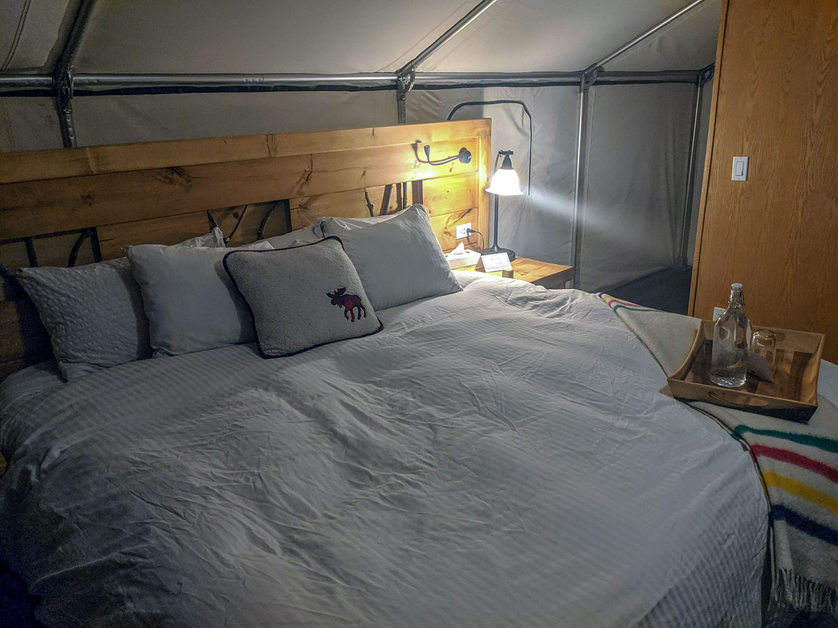 Mount Engadine Lodge king size bed inside glamping tent