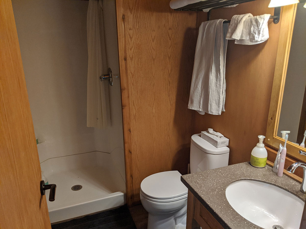 Mount Engadine Lodge glamping tent private bathroom with shower and it's own heater