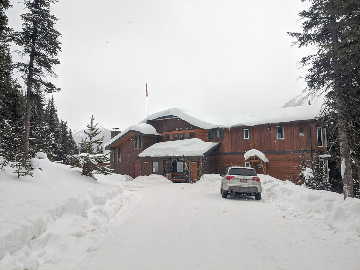 Mount Engadine Lodge main building covered in snow, in the winter