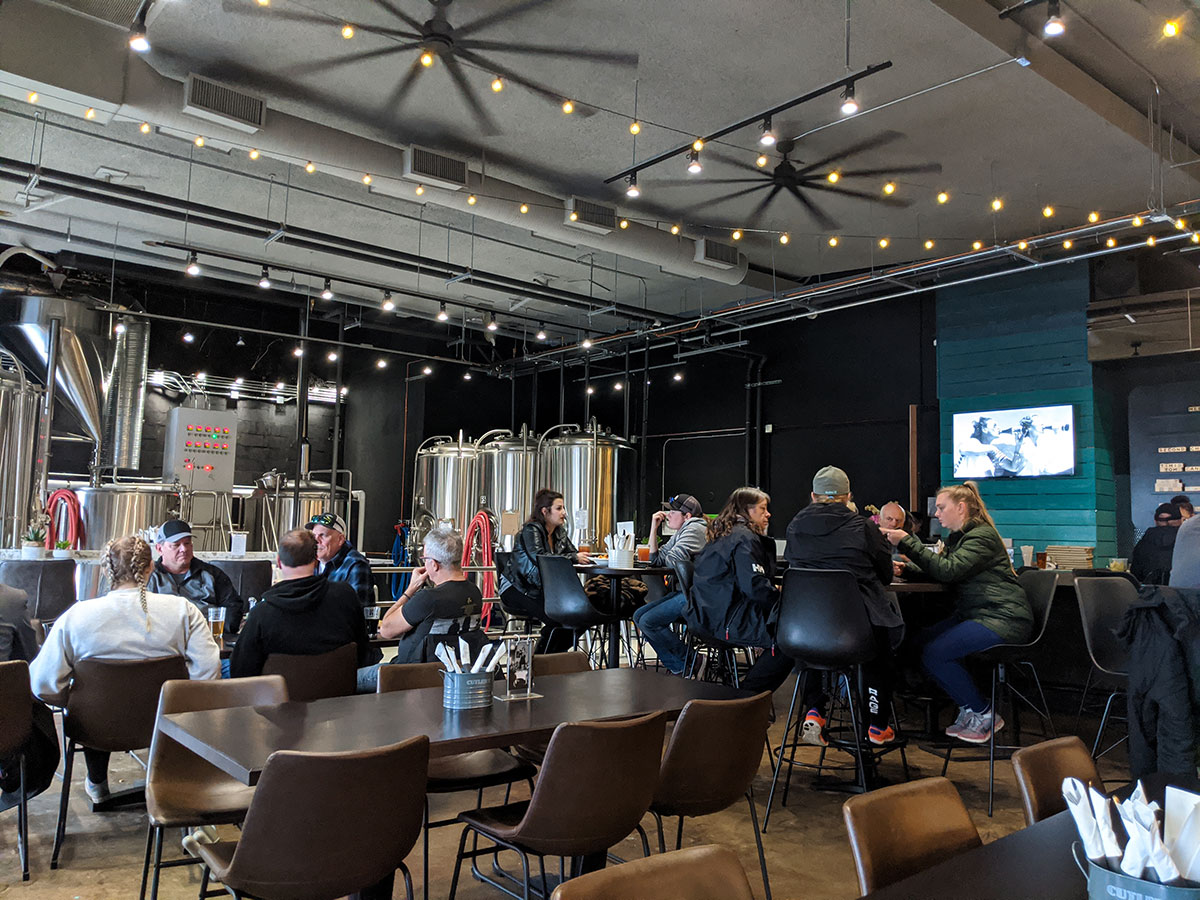 Bitter Sisters Brewing Company inside main room with chairs and people