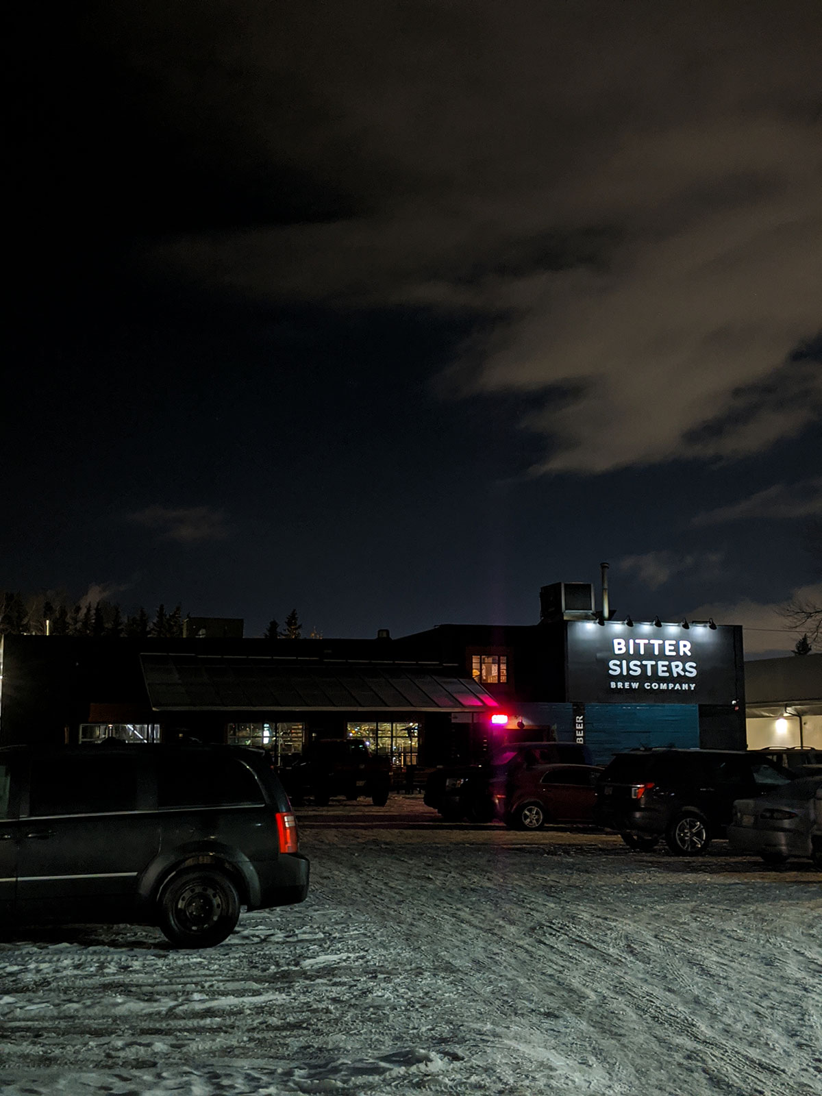 outside Bitter Sisters Brewing Company at night during winter
