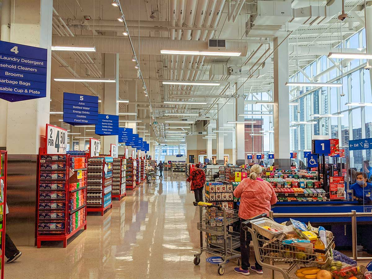 Real Canadian Superstore East Village in Calgary cashiers wide aisles lots of natural lighting