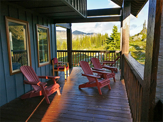 Purcell Mountain Lodge deck with chairs early morning breakfast view