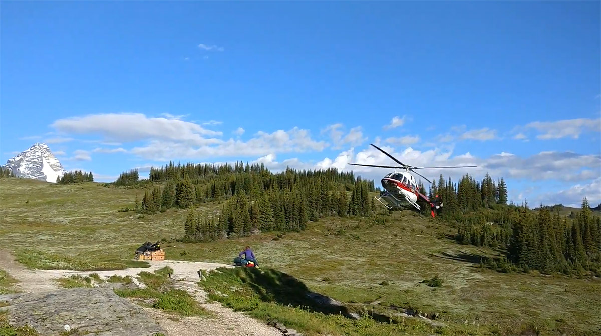 Purcell Mountain Lodge Alpine Helicopters picking passengers up to leave