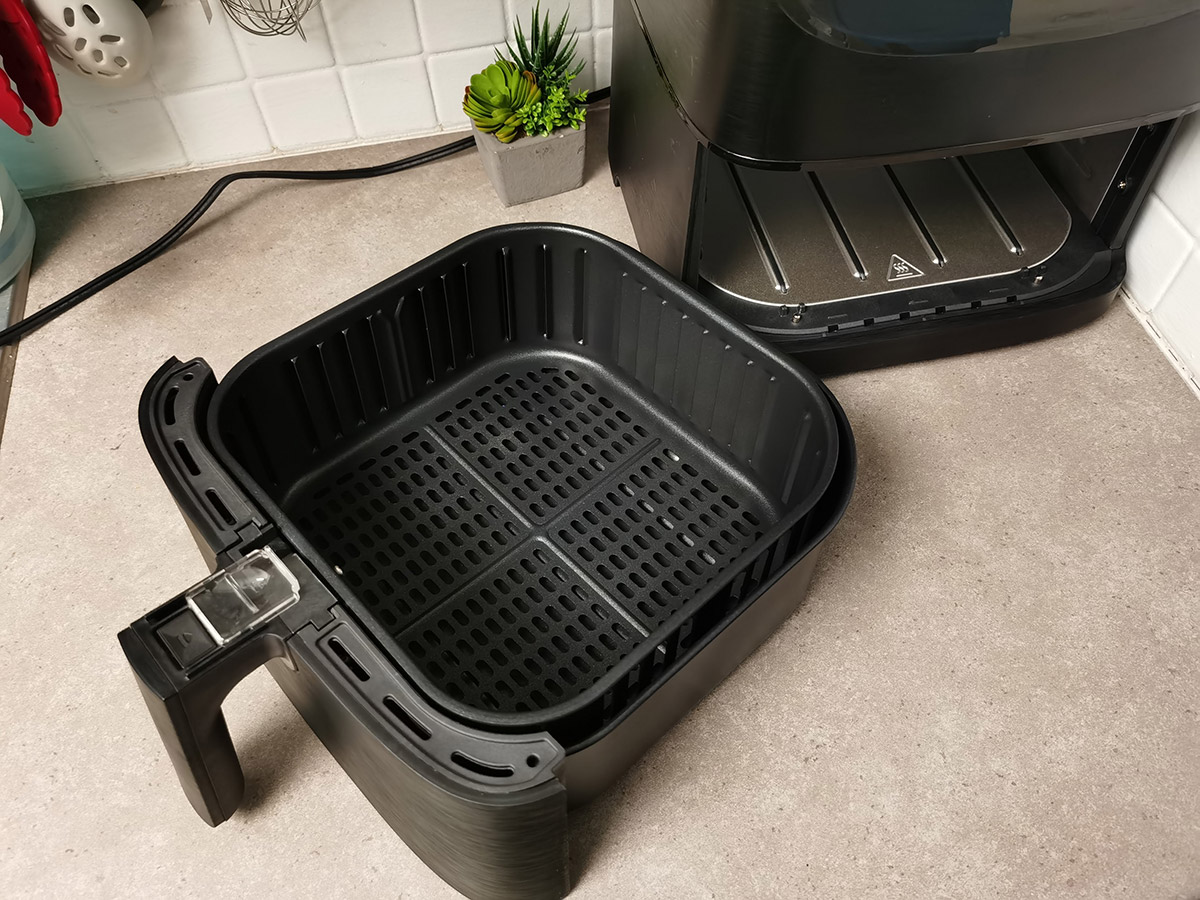 COSORI 5.8QT Air Fryer From Amazon on counter top with frying basket